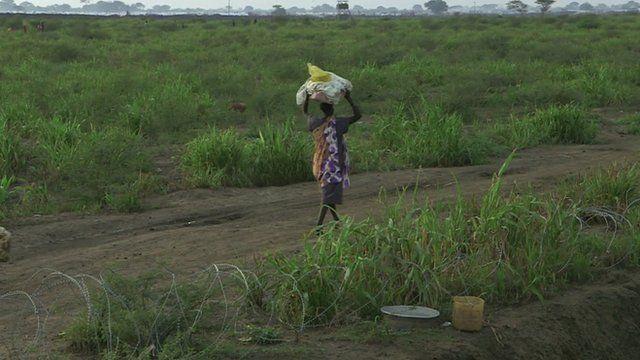 Woman walking in South Sudan