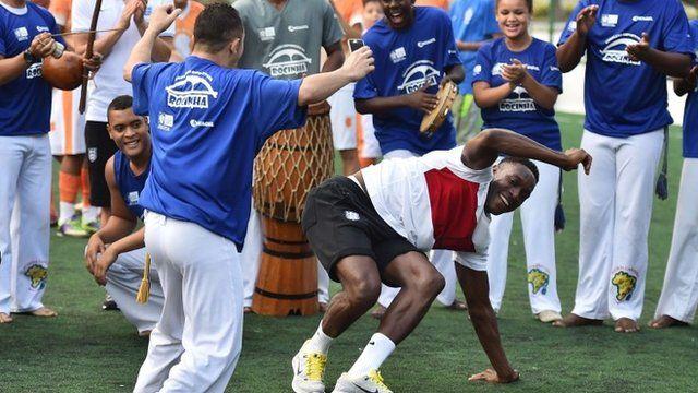 Players dancing capoeira