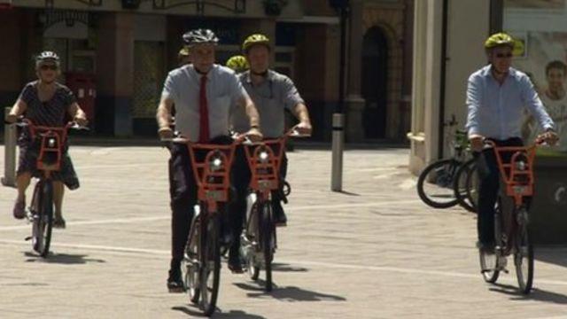 People on hired bikes