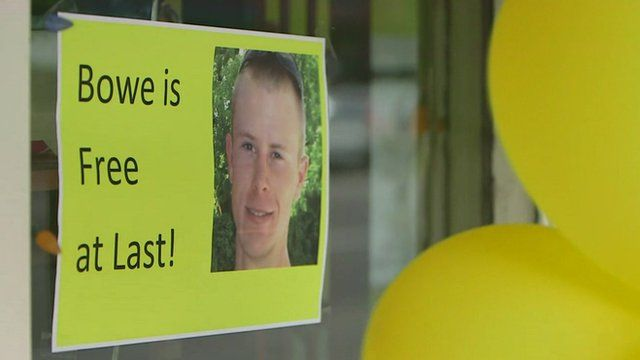 Yellow balloons and poster reading 'Bowe is free at last'