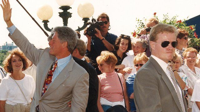 President Bill Clinton and Secret Service Agent Dan Emmett in a crowd in Georgetown, 1993