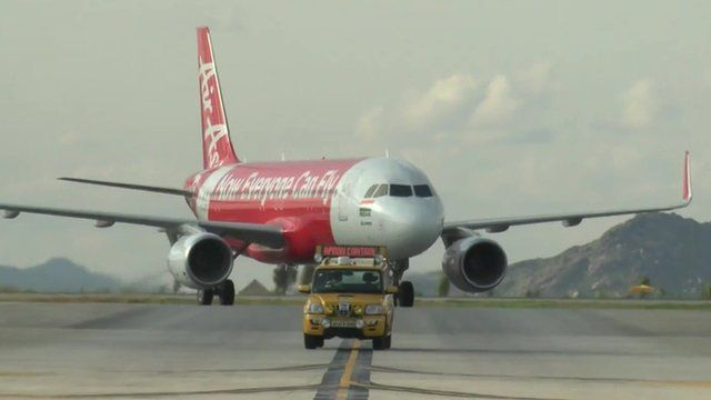 Air Asia aircraft on a runway
