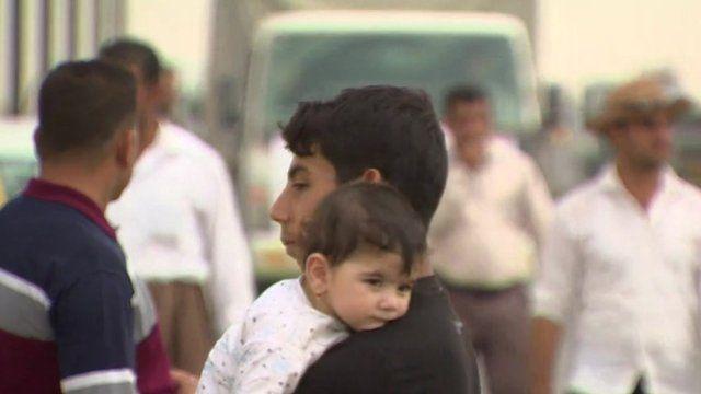 Man with child in Iraq