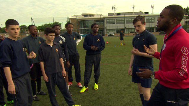 Pupils receiving football coaching