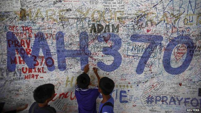 Children in front of MH370 prayer wall