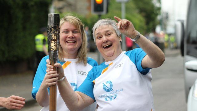 Two women hold the baton on Day 2 of the Queen's Baton Relay in Scotland