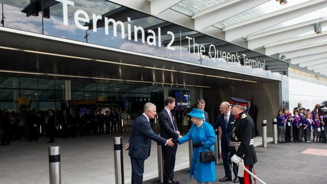 Queen Elizabeth II and Prince Philip, Duke of Edinburgh are greeted by Nigel Rudd, Chairman of London Heathrow, John Holland-Kaye Heathrow Development Director and Colin Matthews,