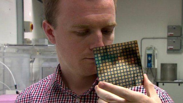 Dr Jon Major with a solar cell