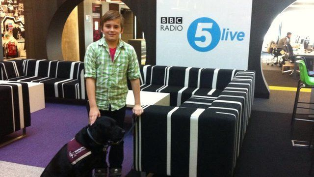 Sam with Ember, his hearing dog