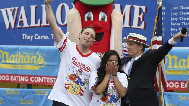 Joey Chestnut and his fiancée