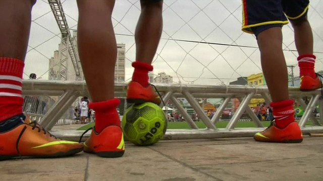 Boys playing football in the Street World Cup
