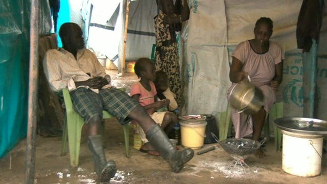 A displaced family in a refugee camp