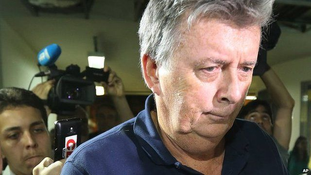 Ray Whelan arrives at police station after been arrested in Rio. 7 July 2014