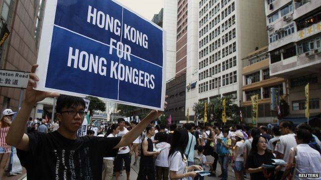 Protester holding sign reading 'Hong Kong for Hong Kongers', July 1, 2014
