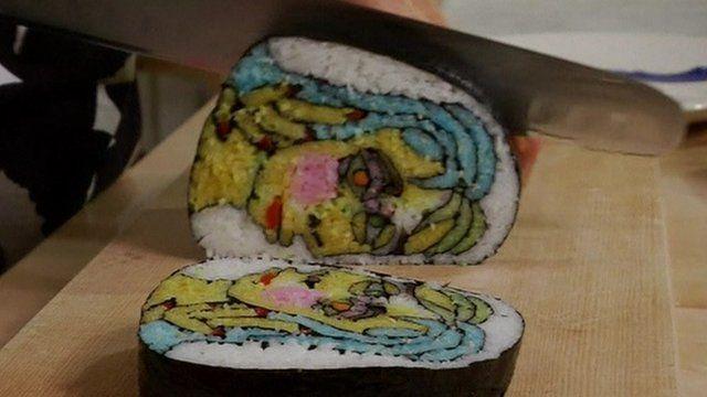Knife cutting through sushi roll