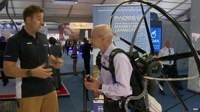 Tom Prideaux-Brune (on the left) and the BBC's Theo Leggett kitted out in a paramotor