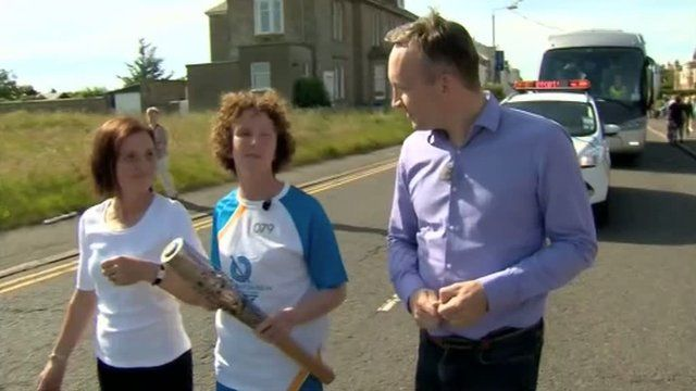 BBC reporter Graham Stewart with baton bearer Hazel McFarlane