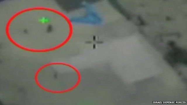 A still image from footage released by the Israel Defense Forces purports to show the moment an air strike was abandoned over Gaza to spare civilian lives