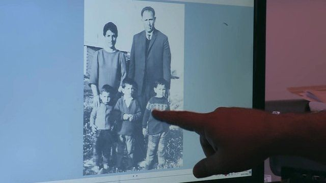 Petros Souppouris points at a photograph of the family he lost in a massacre