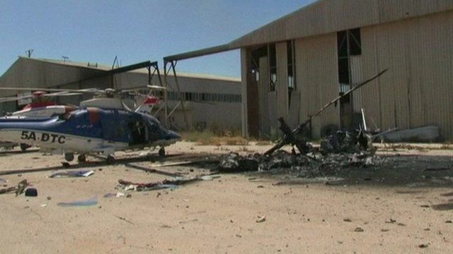 Burnt out helicopters at Tripoli airport