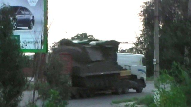 Truck apparently carrying an SA-11 missile launcher heading back to Russia
