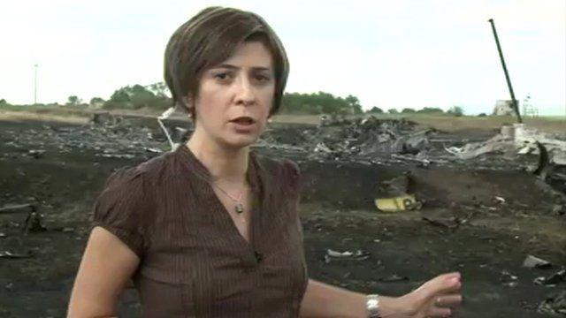 Natalia Antelava gestures towards crash site