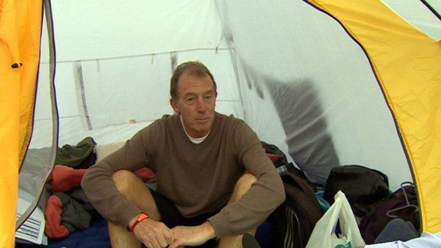 Man sitting in a tent