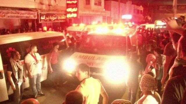 Ambulance in crowd near Qalandia checkpoint
