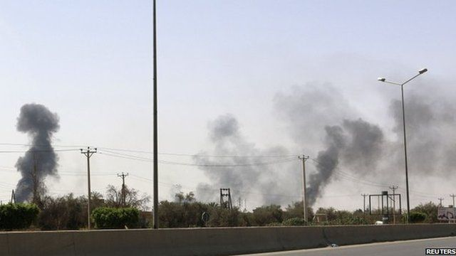 Smoke rises over the Airport Road area after heavy fighting between rival militias broke out near the airport in Tripoli on 25 July 2014.