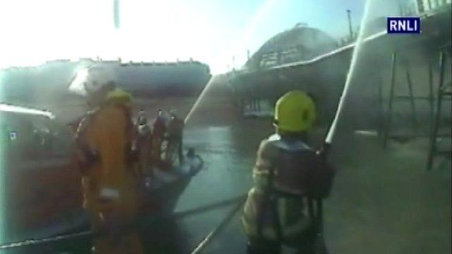 Fire crews battle pier blaze