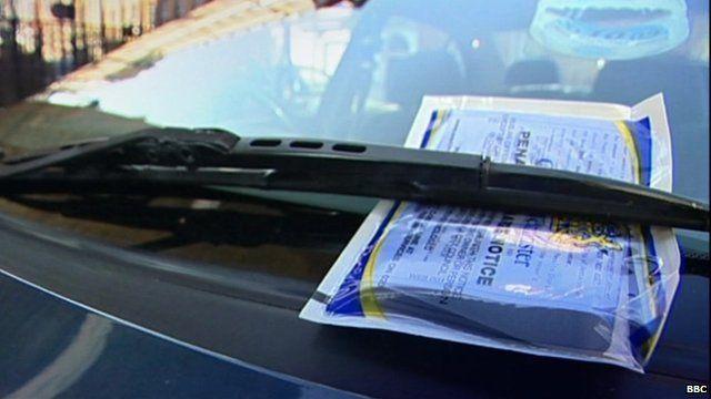 parking ticket on car window