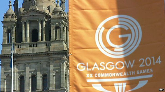 Glasgow building with orange banner showing logo of Commonwealth Games 2014