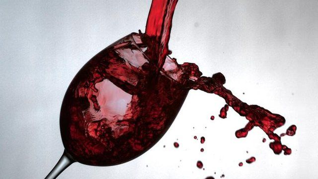 Red wine poured into empty glass