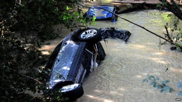 Cars swept away by flash floods