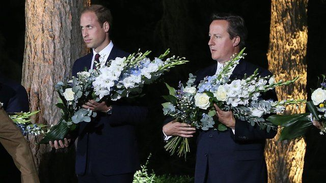 The Duke of Cambridge and Prime Minister David Cameron lay flowers during a Ceremony at the St. Symphorien, Mons, commemorating the 100th anniversary of the start of the First World War.
