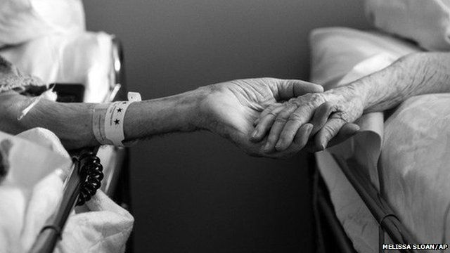 Don and Maxine Simpson hold hands