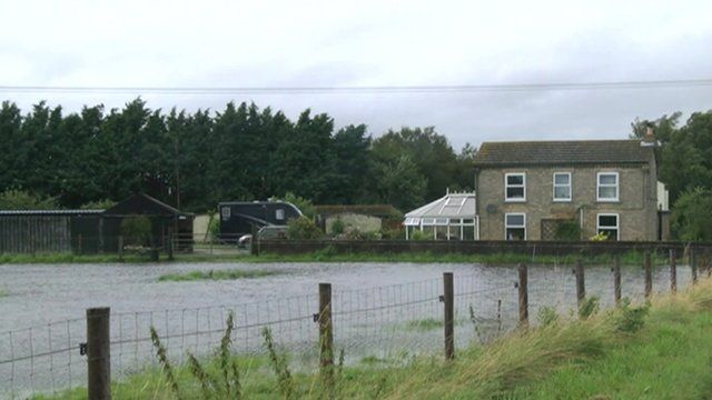 Fenland house surrounded by floodwater