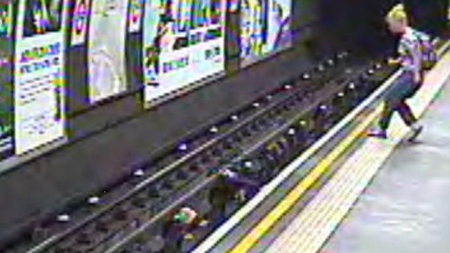Woman rescues child after pushchair falls on to Tube track