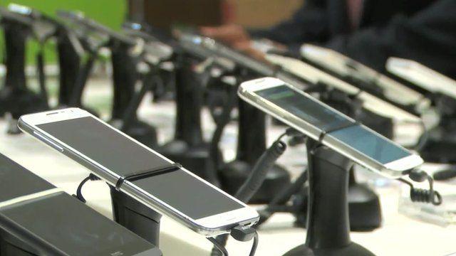 row of smartphones in a shop
