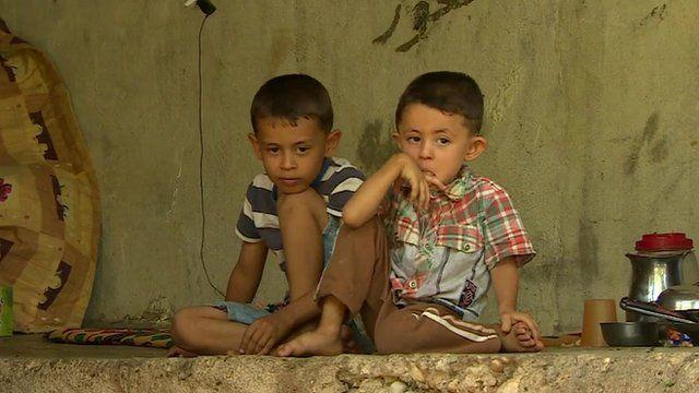 Yazidis children sat on wall