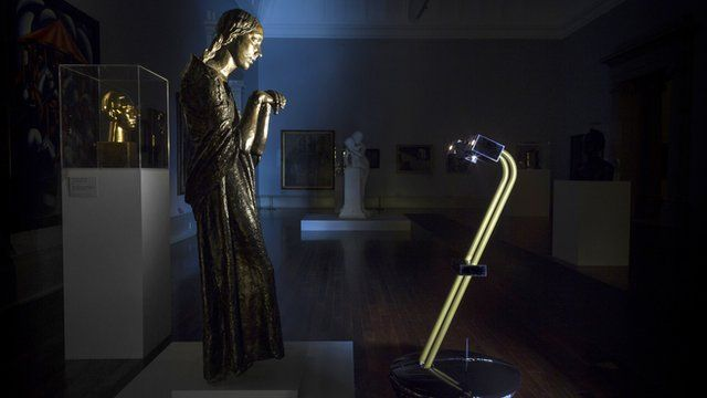 """After Dark project robot in front of Jacob Epstein""""s The Visitation (1926) inside Tate Britain in London."""
