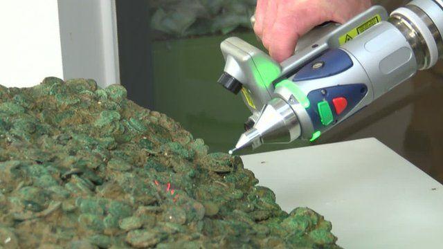 Laser scanning the coins