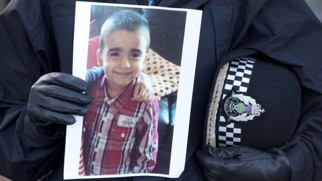 Image of Mikaeel Kular held by police officer