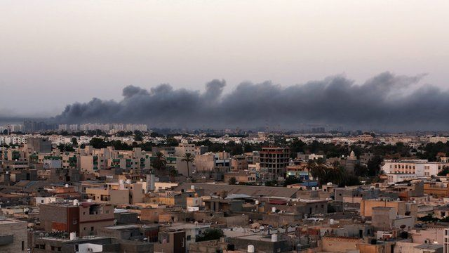 Smoke fills the sky over Tripoli