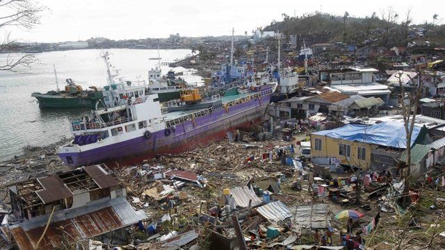Ship run aground surrounded by debris in the Philippines following Typhoon Haiyan
