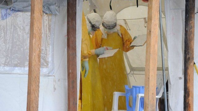 Health care workers in protective clothing in Liberia