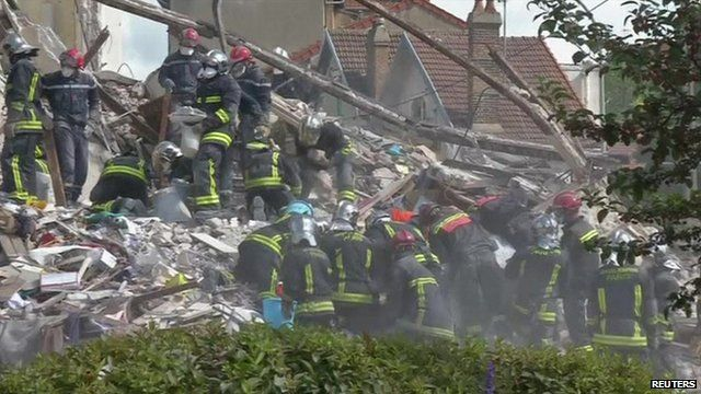 Emergency workers at scene of collapsed building