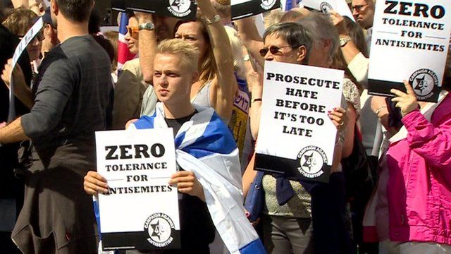Members of the Campaign against Anti-Semitism carrying banners calling for prosecution of anti-Semites