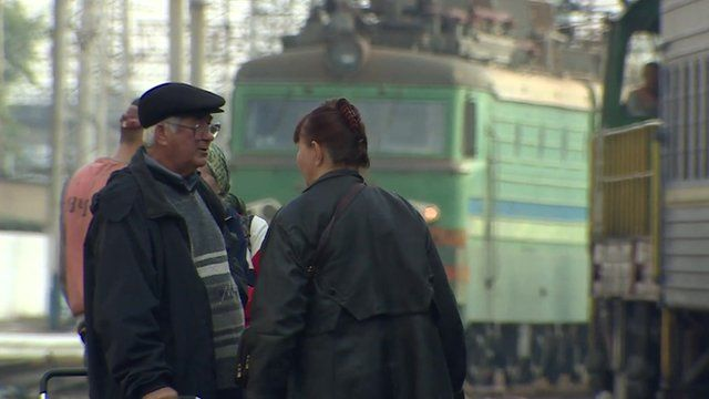People at a train station in Ukraine