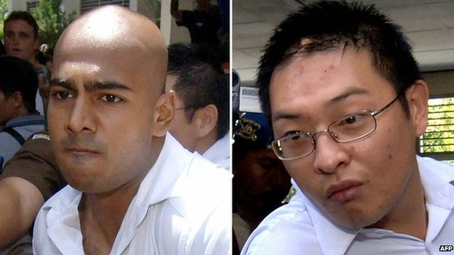 Myuran Sukumaran (L) and Andrew Chan (R) being escorted out of a court in Denpasar, on Bali island, 14 February 2006